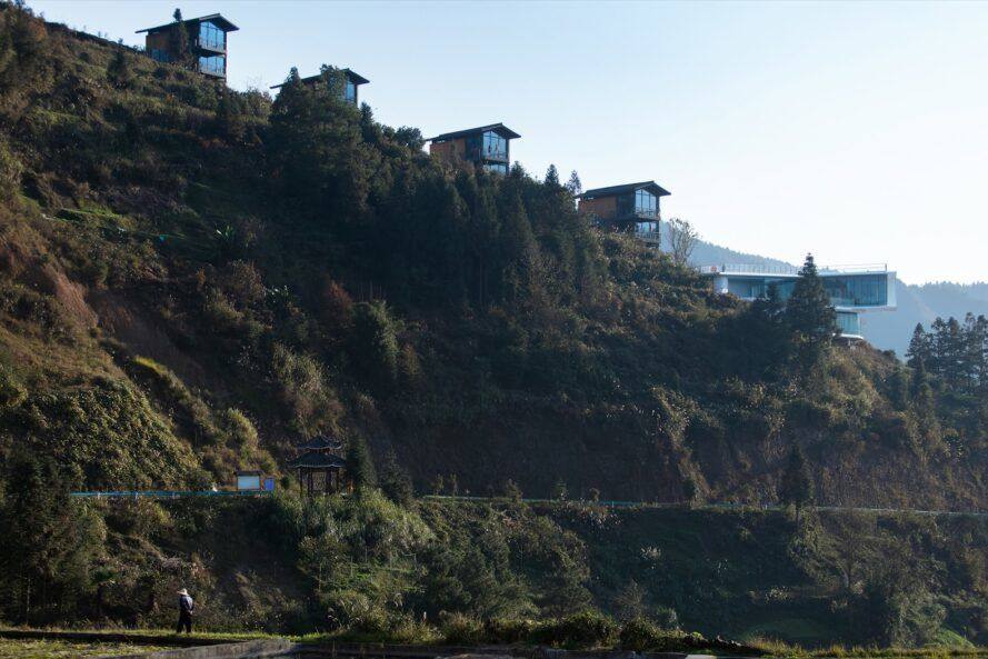 a series of wooden hotel buildings on the hillside