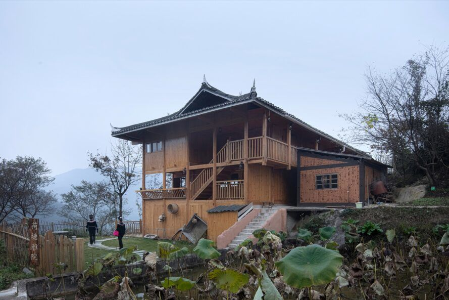 Large wooden building on the foggy hillside
