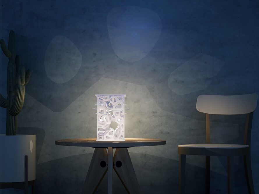 White 3d printed lamp on wooden table