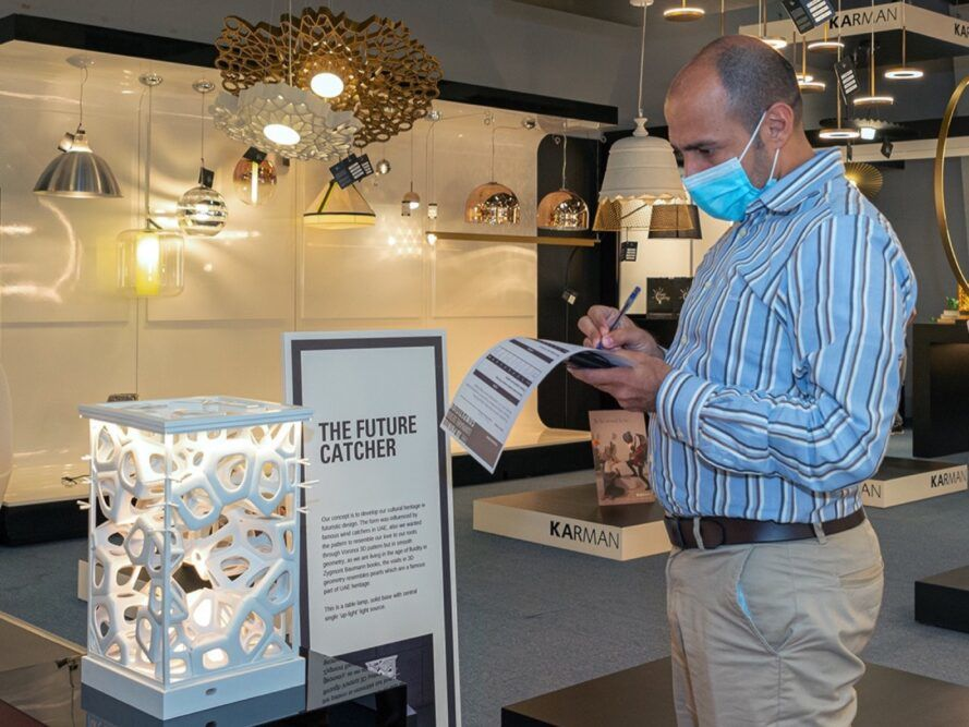 person looking at exhibition 3d printed lights