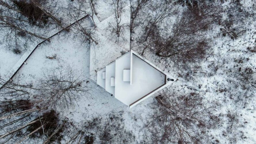 aerial view of diamond-shaped cabin in snowy landscape