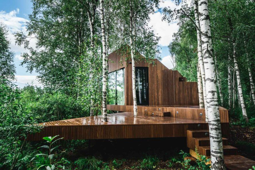 wood cabin with large wood deck