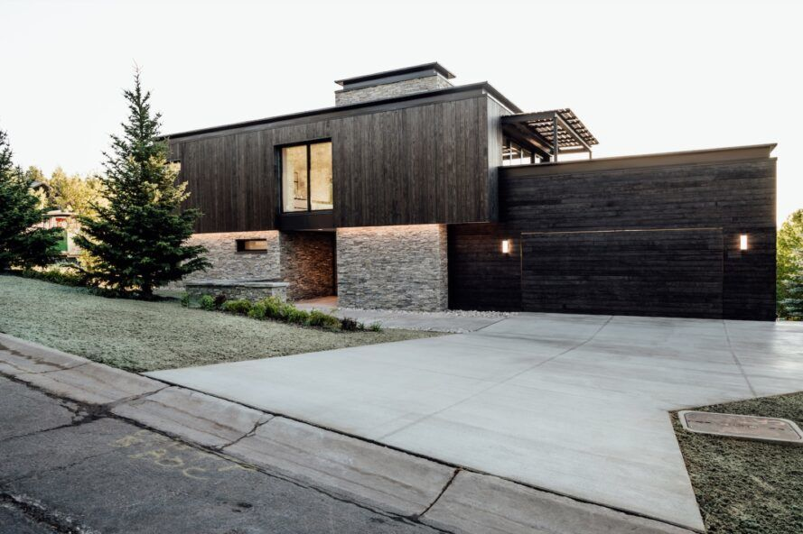 black wood and stone home