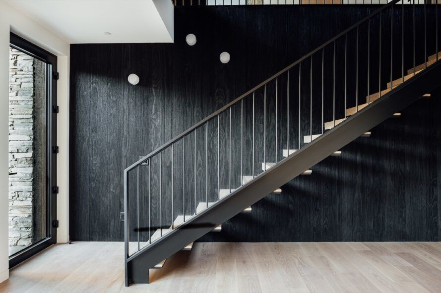 staircase against charred wood wall