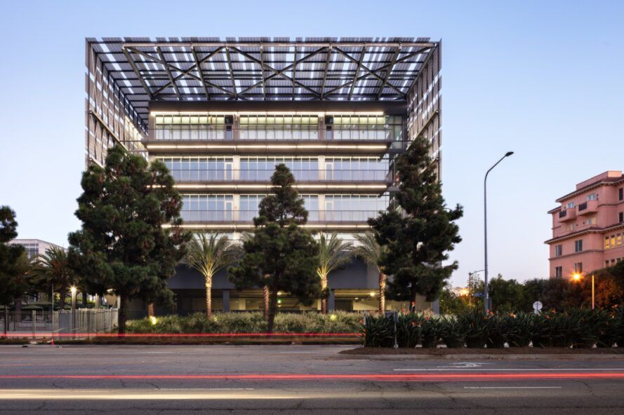 extended roof over a glass office building