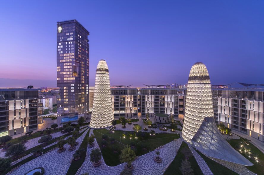 large, rounded silver buildings in a cityscape at dusk