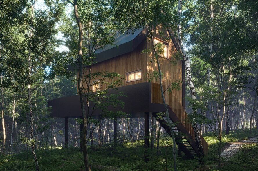 An elevated wood treehouse with a staircase in a forest.