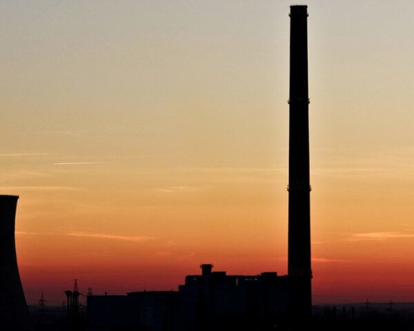 silhouette of coal plant at sunset