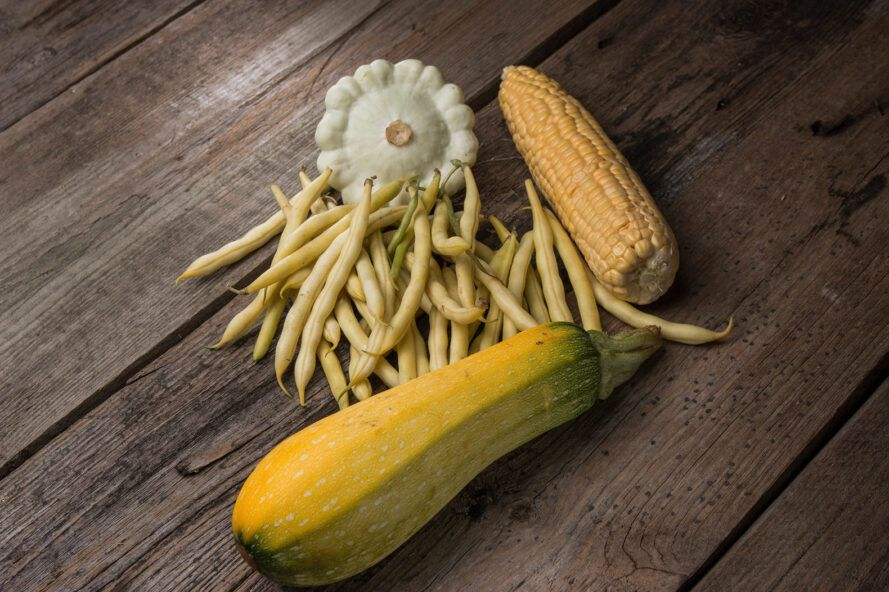 okra and squash on a wooden background