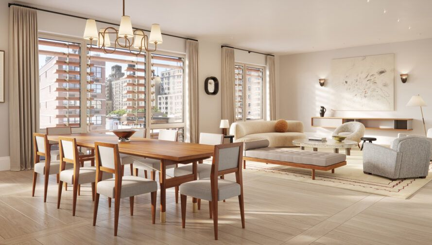 open-plan apartment with wood dining table and beige sofa