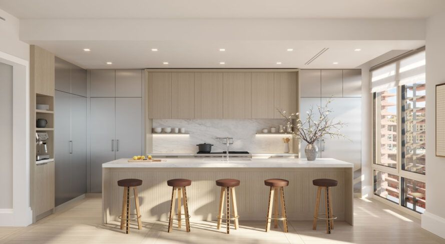 kitchen with long island and beige cabinets