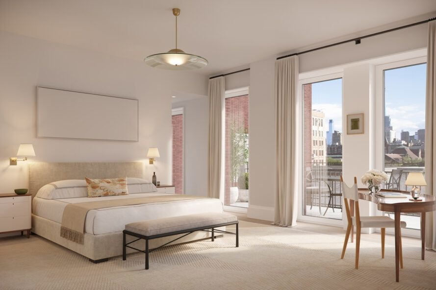 large white bed in bedroom with floor-to-ceiling windows