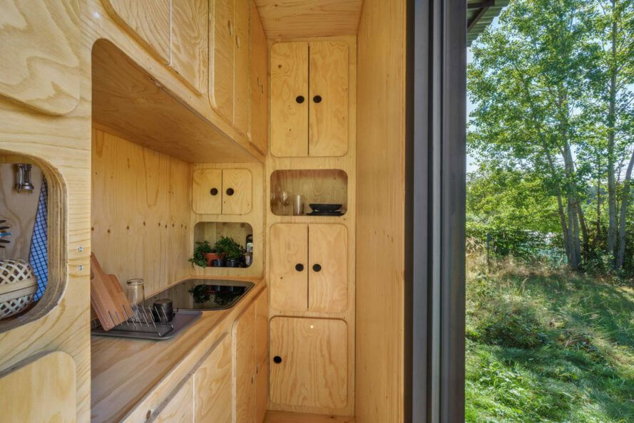 tiny kitchen with wood cabinets