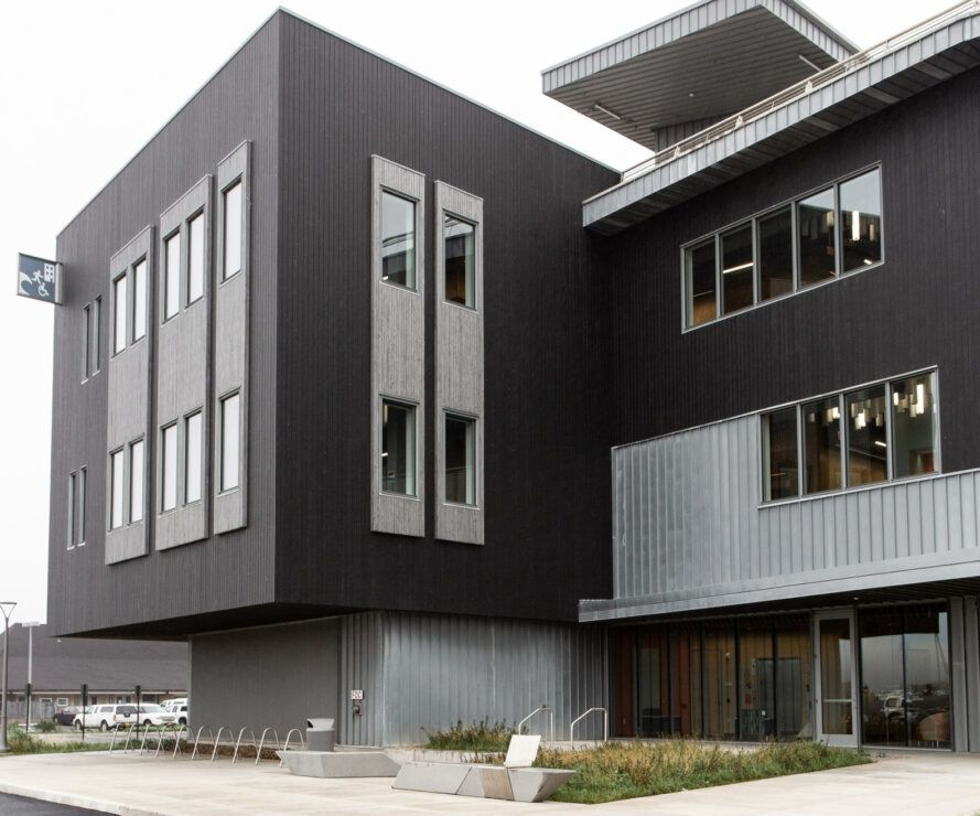 black and gray three-story building