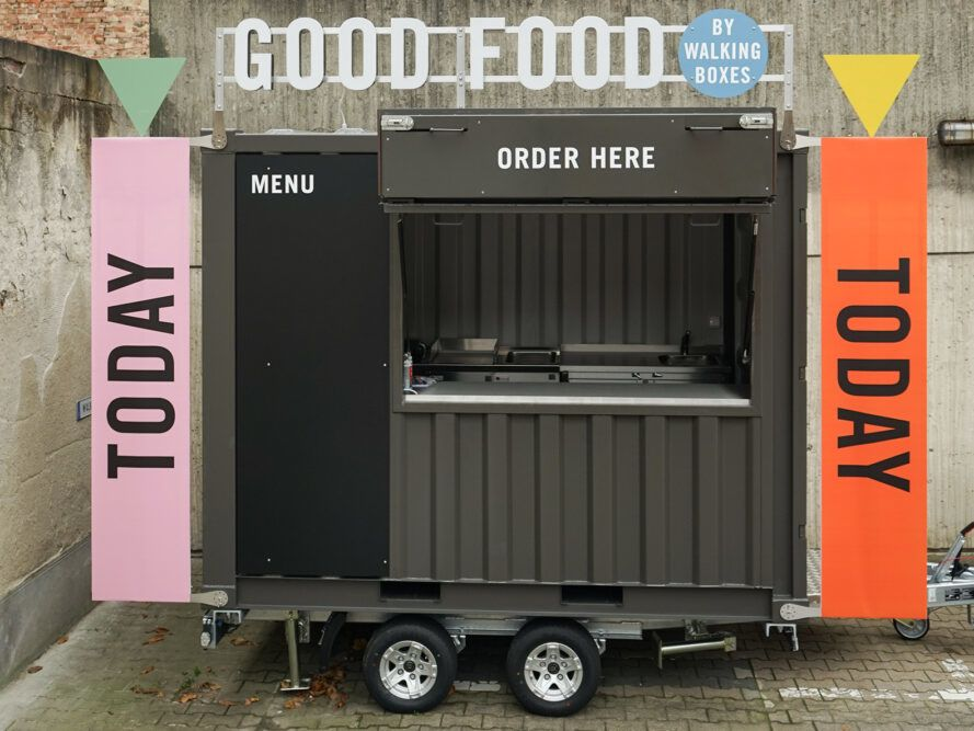 Black food truck with modular signage