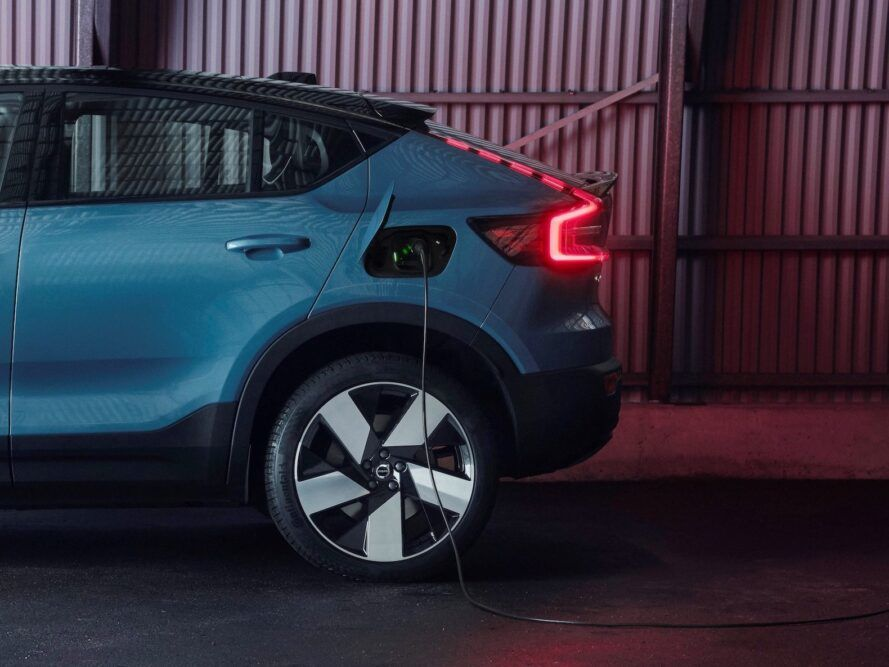 charging cord hanging out of side of electric car