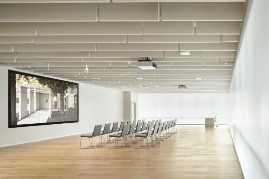 rows of chairs facing a screen