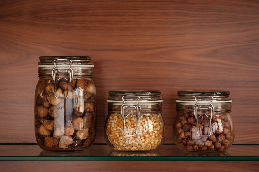 glass jars of nuts and seeds
