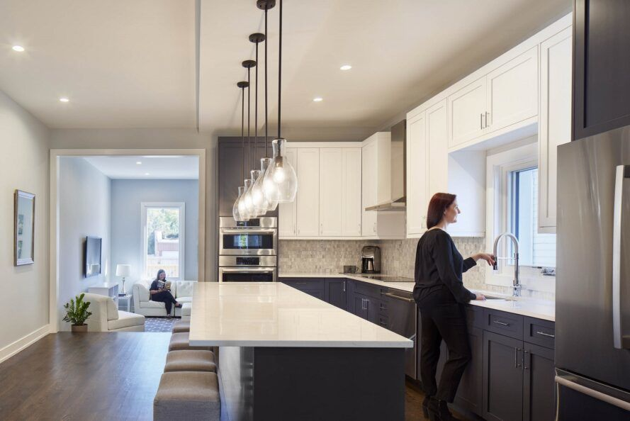 person in gray and white kitchen