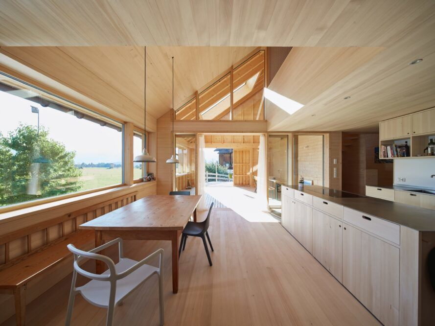 wood kitchen near wood dining table