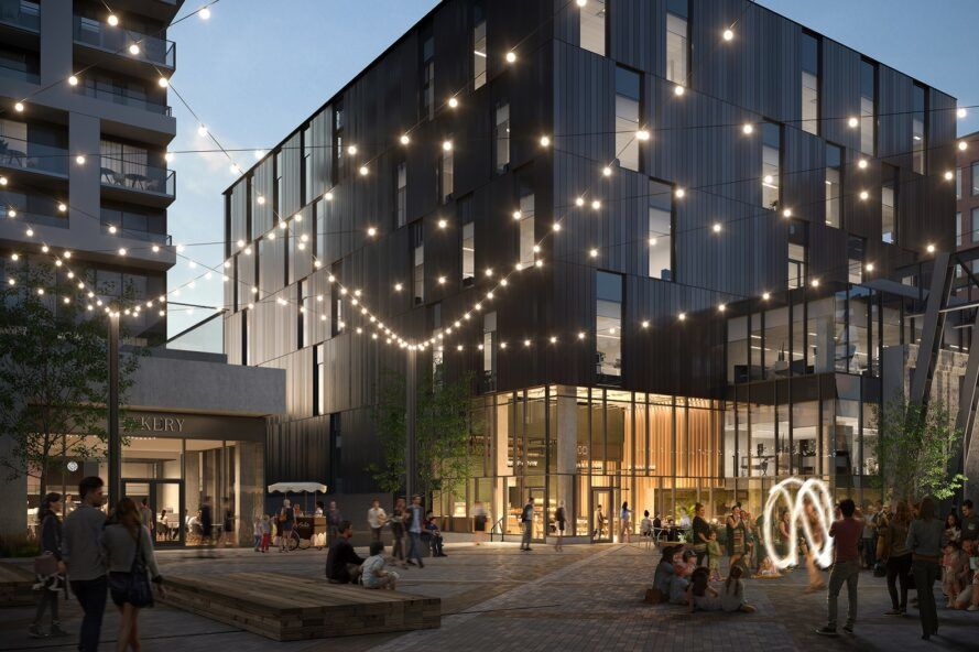 rendering of twinkle lights above a patio near two large buildings