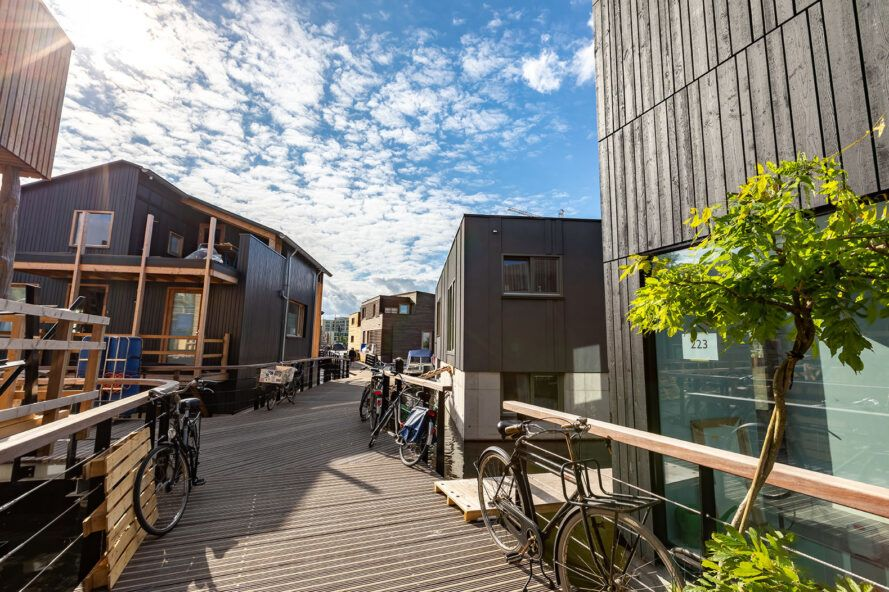 bikes parked along wood path connecting floating homes