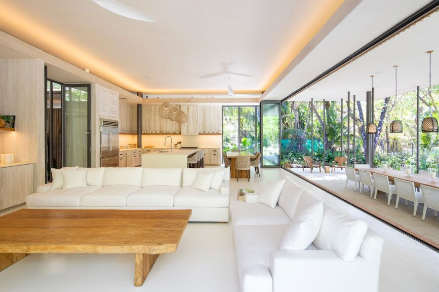 large white sofas in room with glass walls