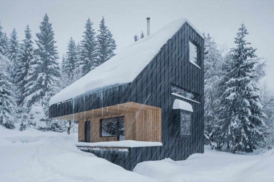 angled cabin covered in snow