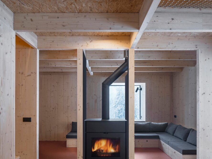 L-shaped sofa around a central wood-burning stove