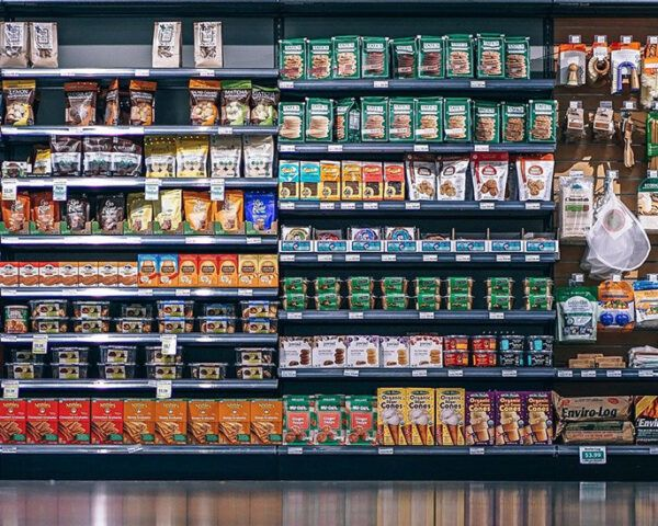 array of products on shelves in grocery store