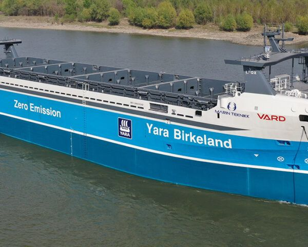 blue Yara ship on water