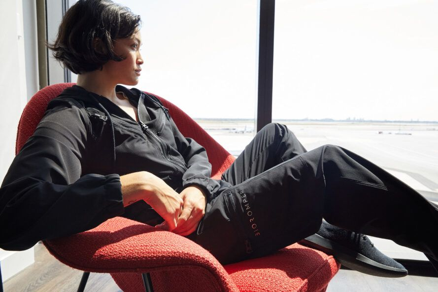 person lounging while wearing black jumpsuit