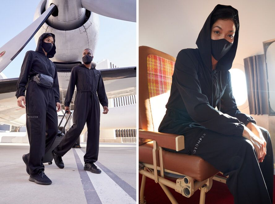 people boarding plane while wearing black jumpsuits
