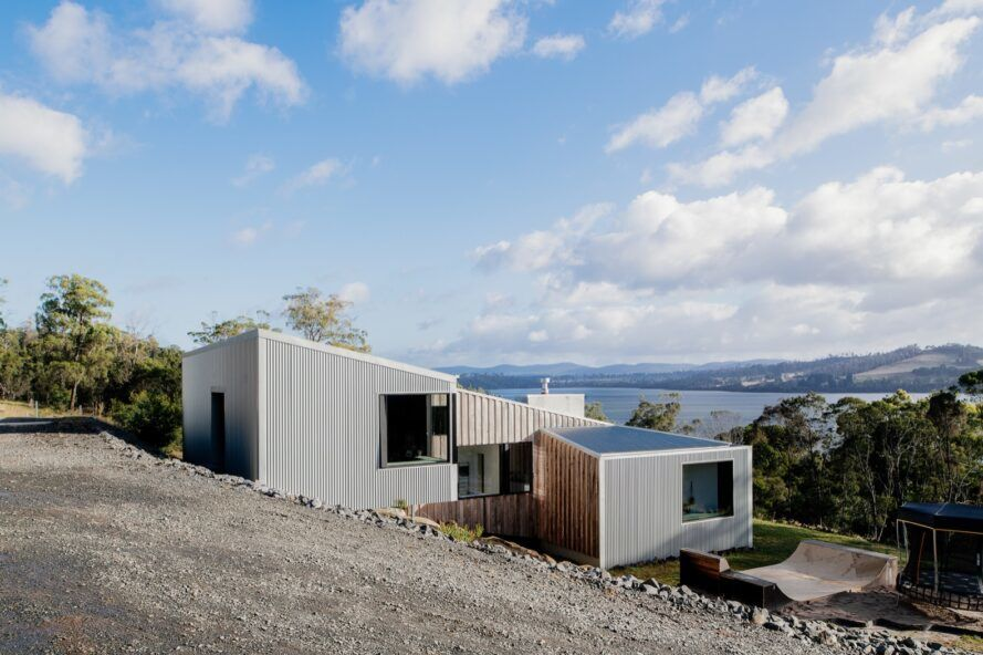 gray home with sloped roof covered in solar panels