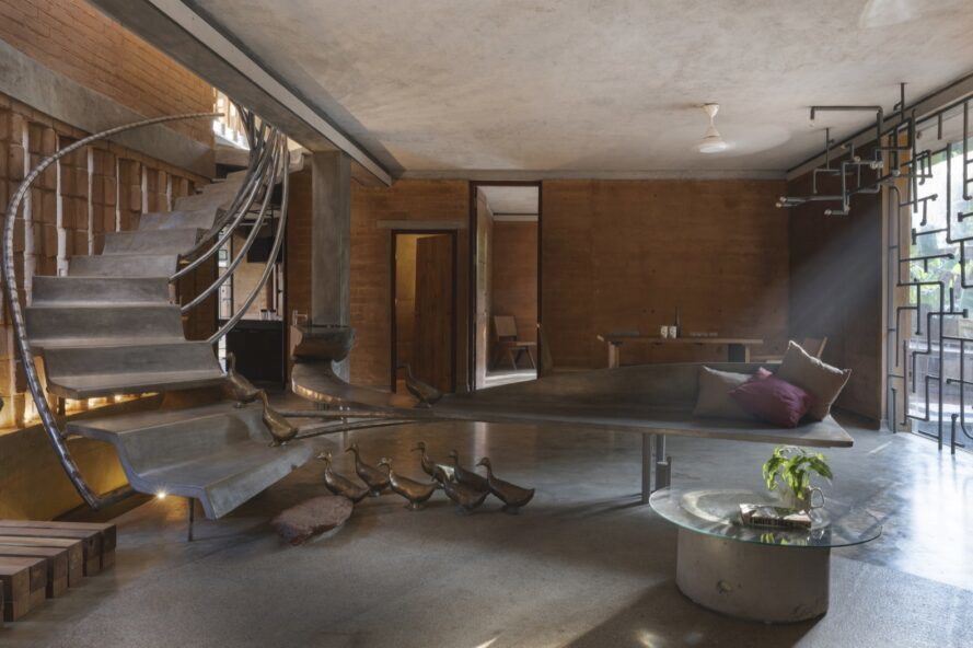 concrete bench and staircase inside rammed earth home