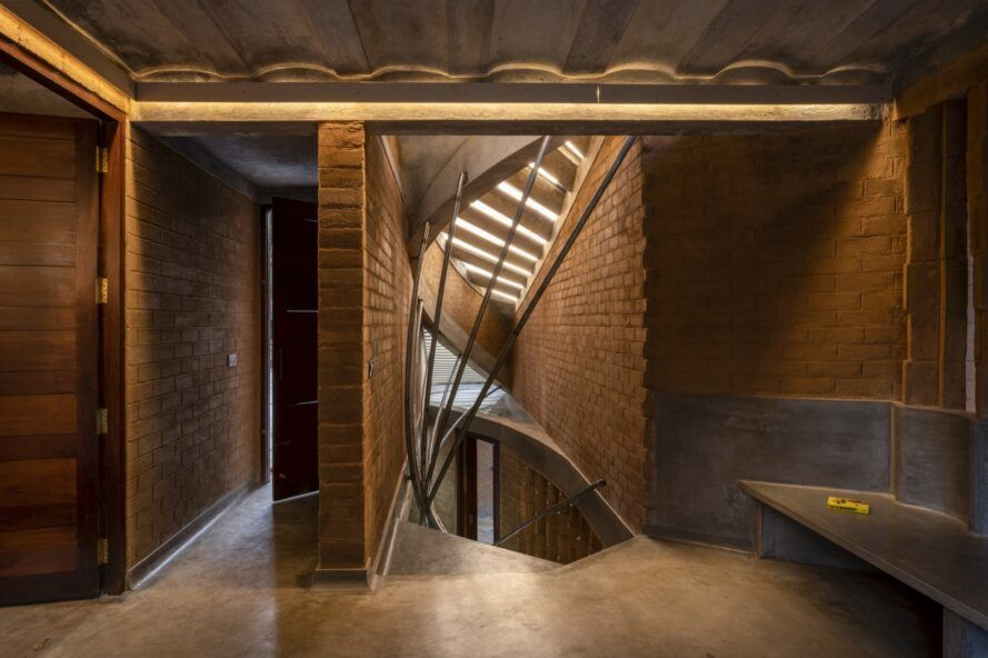 metal and concrete staircase inside rammed earth home