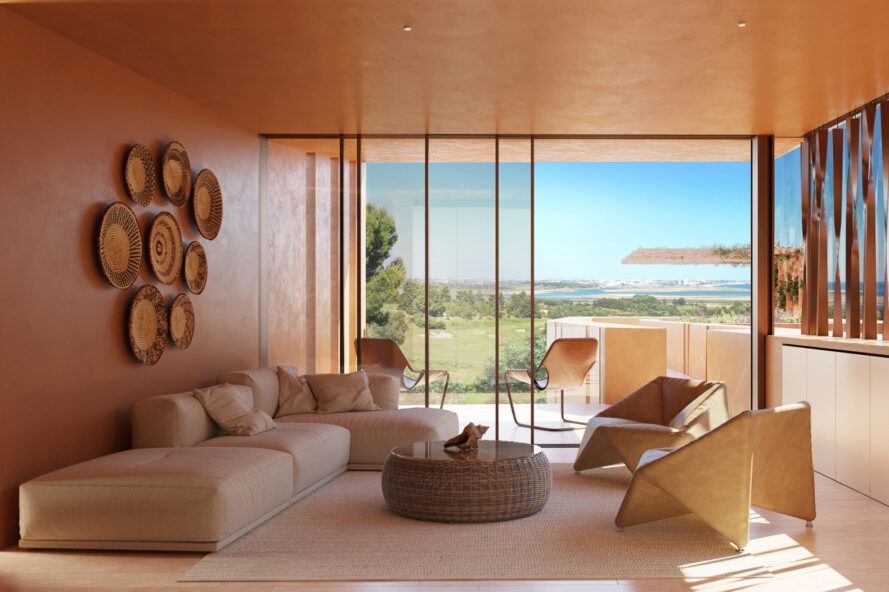 resort living room with glass wall revealing ocean and golf course views