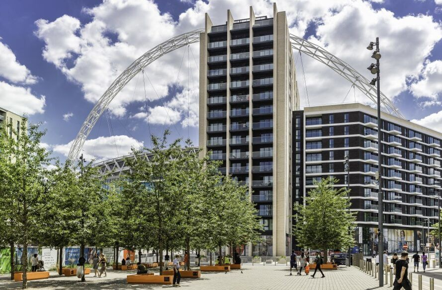 Wembley park as viewed from tree lined street.