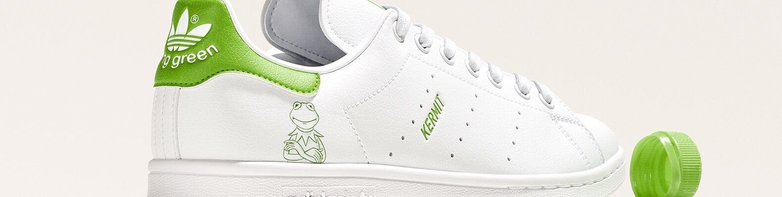 white and green sneaker with Kermit the Frog design