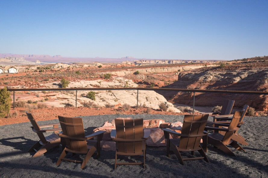 chairs around a firepit with desert views