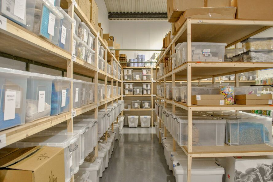 A warehouse with wood shelves.