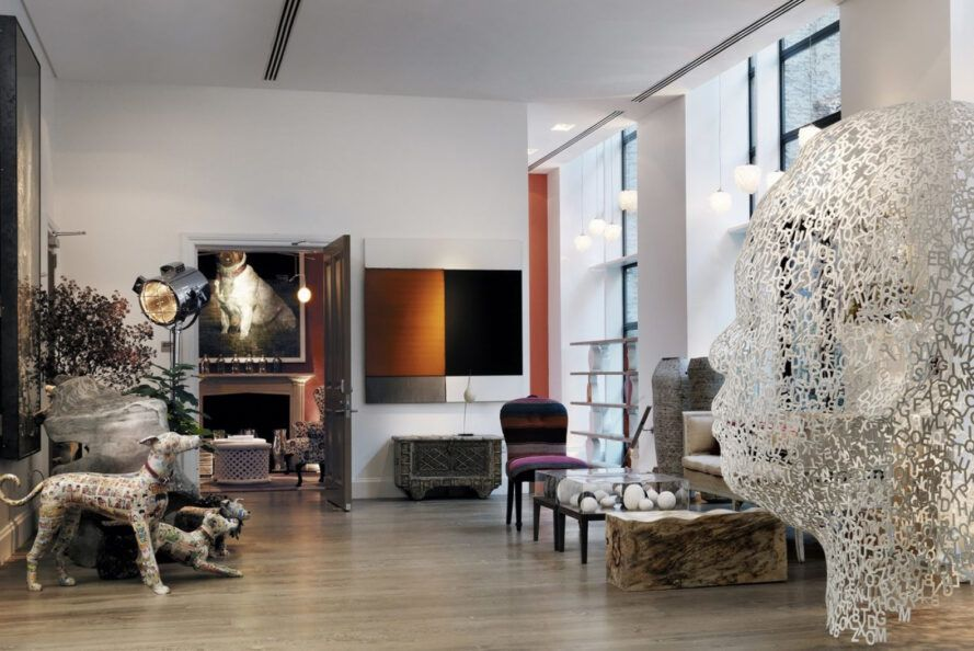 A hotel room decorated with modern artwork and sculptures.