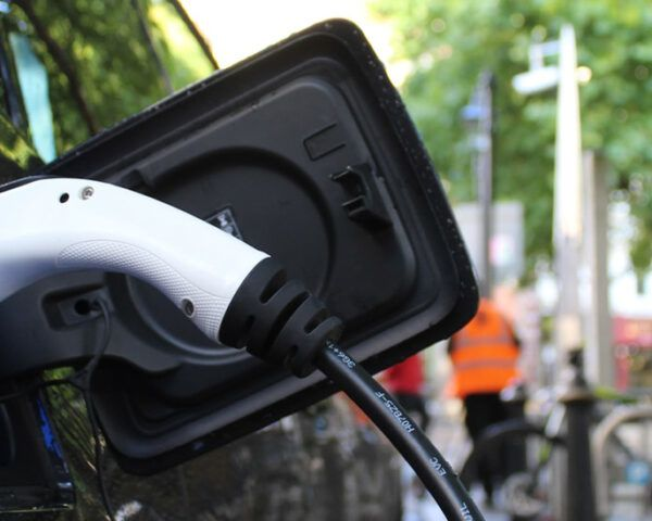 charger plugged into electric car