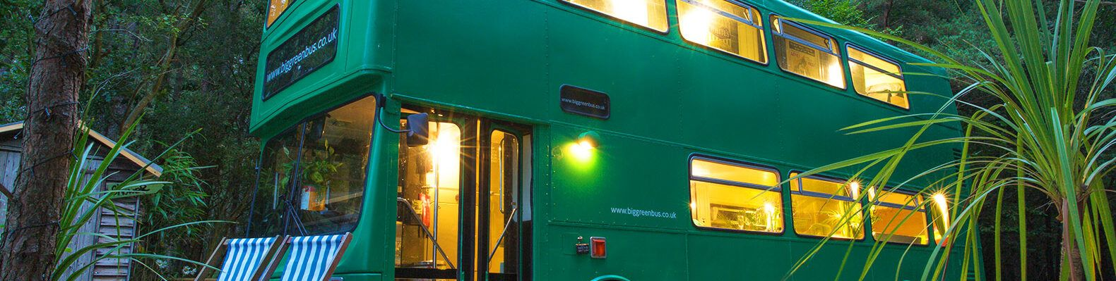A sideview of the green bus.