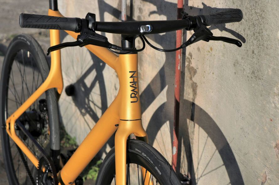 A close-up of the handlebar of a yellow bike.