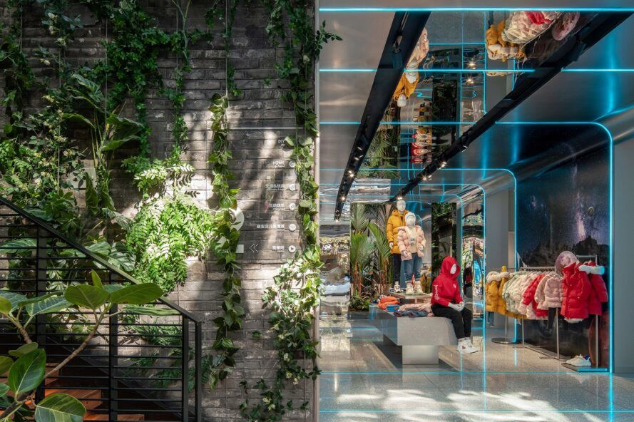To the left, a green wall by a steel staircase. To the right, a children's clothing store.