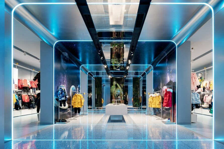 A children's clothing store with a futuristic style and blue lighting.