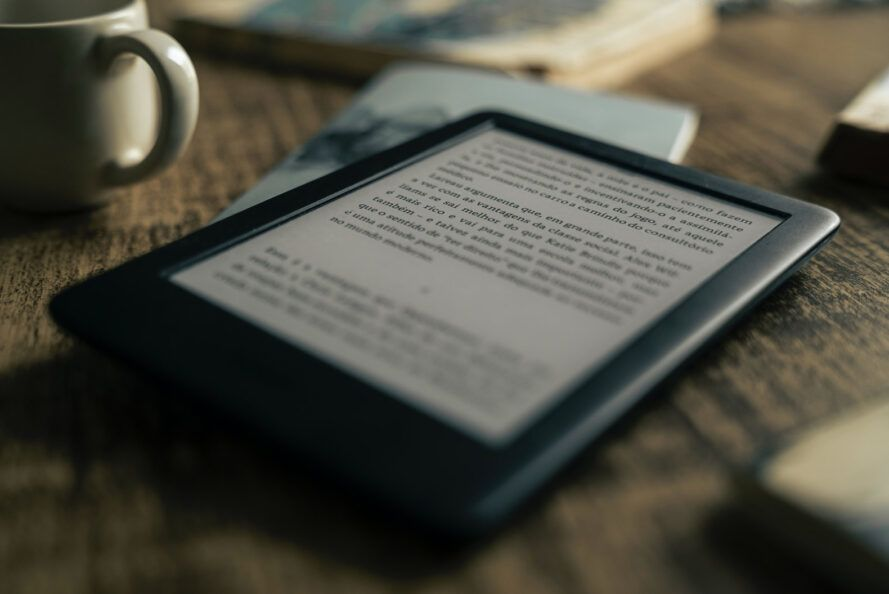 e-reader on wood table