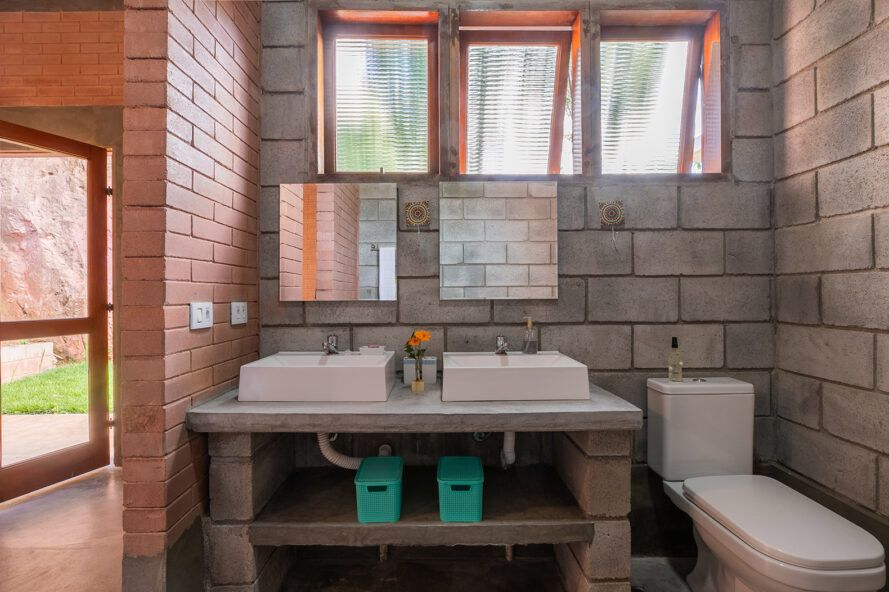 modern bathroom sink in room with concrete and rammed earth walls