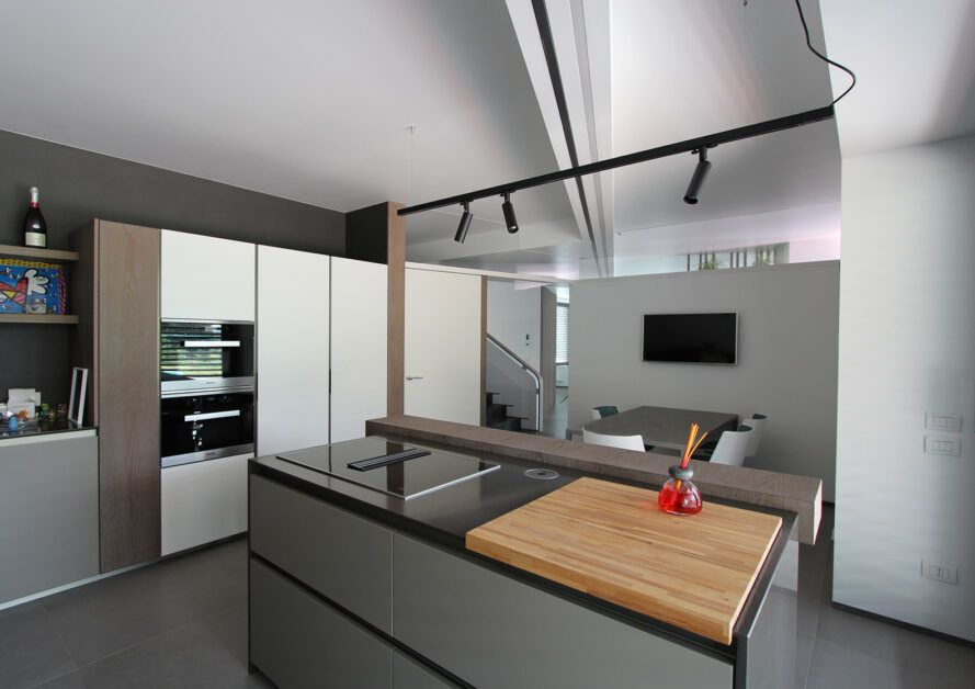 gray and white kitchen with large island